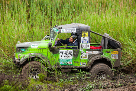 KIRILLOVKA, UKRAINE - MAY 25, 2016: Zaporizhia Trophy 2016. II stage of offroad trophy Ukrainian championship. Participant in GAZ 69 drive through mud.