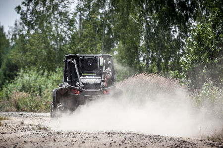 TOLOKUN`, UKRAINE - JULY 2, 2016 :ATL TROPHY 2016. III stage of offroad trophy Ukrainian championship. Back view of buggy riding along a country road.