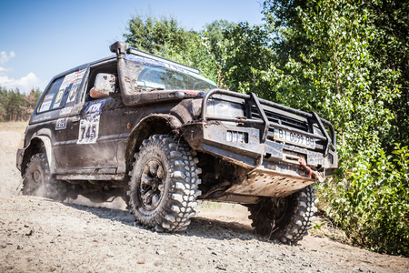 TOLOKUN`, UKRAINE - JULY 2, 2016 :ATL TROPHY 2016. III stage of offroad trophy Ukrainian championship. Heavy off-road racing car driving along the dusty road. Editorial