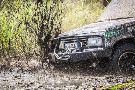 TOLOKUN`, UKRAINE - JULY 2, 2016 :ATL TROPHY 2016. III stage of offroad trophy Ukrainian championship. Closeup of dirty off-road car with splashes of mud. Editorial