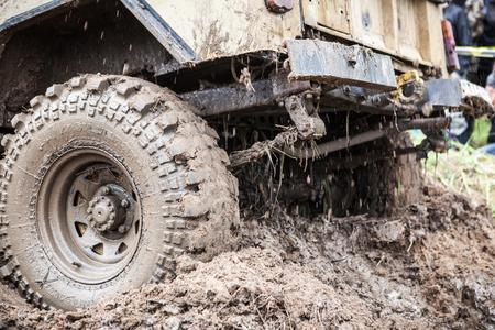 close p: LUBOTIN, UKRAINE - JULY 23, 2016: RFC Ukraine Wild Boar Challenge 2016. Close u p of Uaz 469 overcomes a muddy pit.