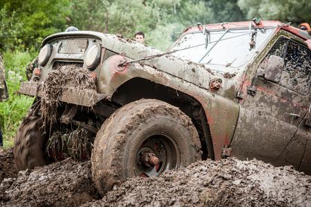 LUBOTIN, UKRAINE - JULY 23, 2016: RFC Ukraine Wild Boar Challenge 2016. Custom built Off-road Trophy UAZ 469 passing mud pit. Editorial