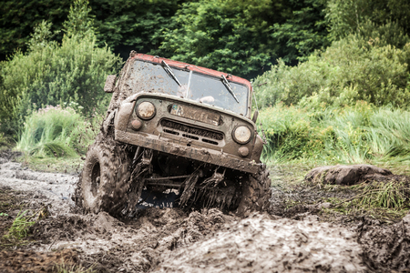 heavy: LUBOTIN, UKRAINE - JULY 23, 2016: RFC Ukraine Wild Boar Challenge 2016. Custom built Off-road Trophy UAZ 469 passing mud pit. Editorial
