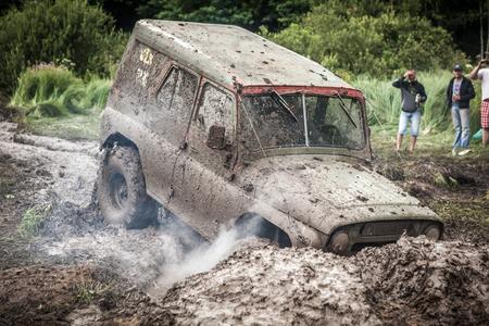 LUBOTIN, UKRAINE - JULY 23, 2016: RFC Ukraine Wild Boar Challenge 2016. Off-road Trophy UAZ 469 stucks in mud pit. Editöryel