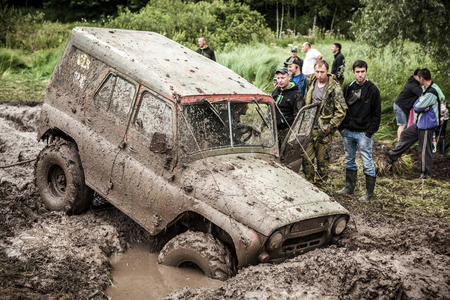 LUBOTIN, UKRAINE - JULY 23, 2016: RFC Ukraine Wild Boar Challenge 2016. Off-road Trophy UAZ 469 stucks in mud pit. Redakční