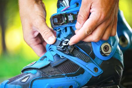 Close up photo of roller adjusting buckle on inline roller skates.