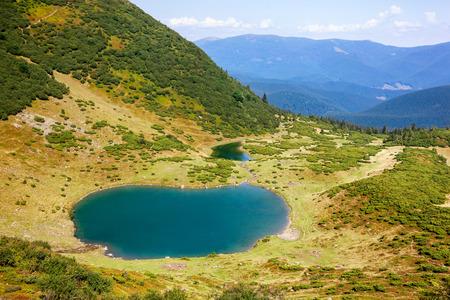 Beautiful hills an Vorojeska lake at Carpathian mountains. Ukraine.