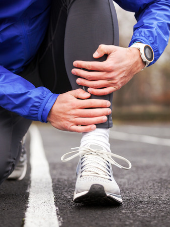 Cropped shot of a young runner holding his leg in pain. Shin splints.