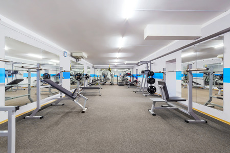 Modern gym interior with sports equipment. Banque d'images
