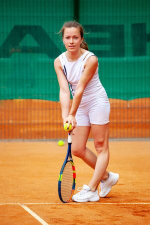 Fullbody portrait of young beautiful female tennis player.