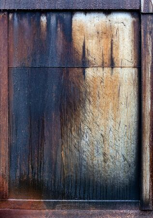 Close up of grungy metal painted panel with leaking oil.