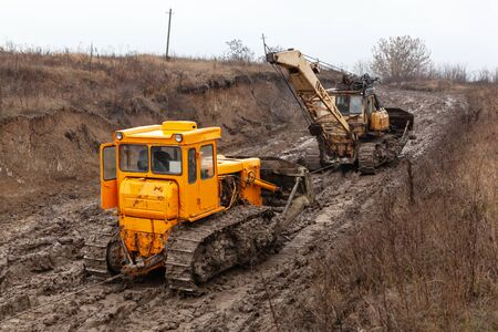 Chain Tracked Bulldozer on mud road.