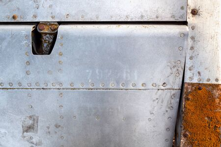 Close up of old aircraft aluminum texture with rivets.