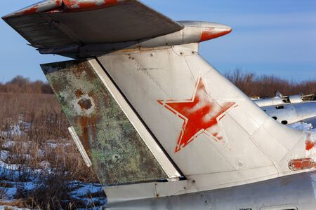 Close up of old aircraft tail with USSR star.