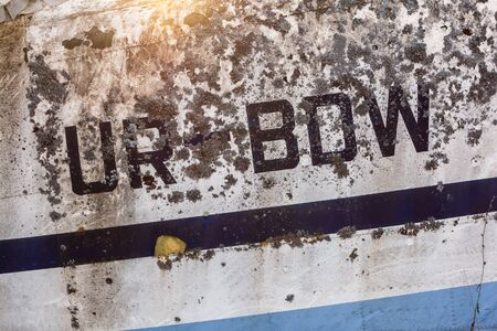 Close up of old aircraft aluminum panel with letters.
