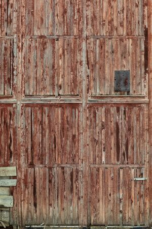 Close up of an old wooden barn door.
