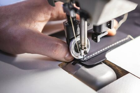 Close up of professional sewing machine for leather work.