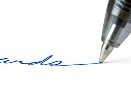 autograph: Ballpoint pen writing in blue ink on white paper Stock Photo