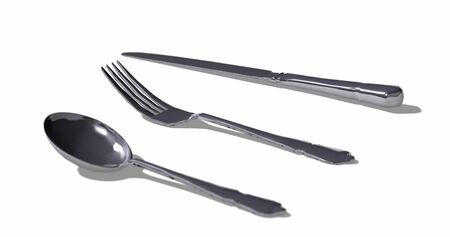 Bright silver fork, knife and spoon on white ground. Isolated shiny gray cutlery. Focus depth. Overhead