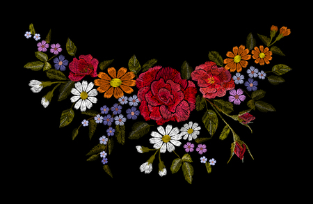 Embroidery colorful floral pattern with red roses and forget me not flowers.