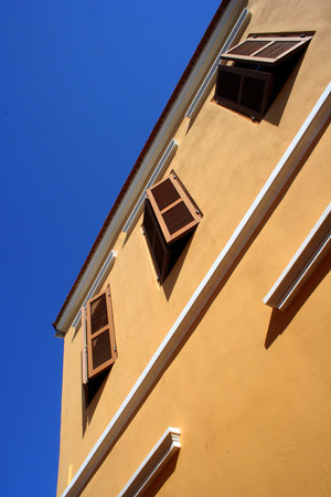 Brown Shutters on Stucco
