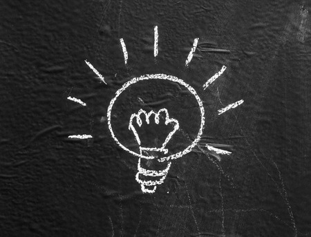 Halogen bulbs are written on the background black boards.