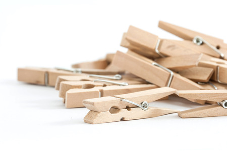 wooden clothespins, isolated on a white background