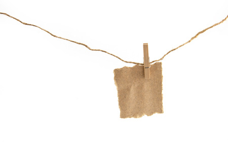 close up of a notes and a clothes pegs on white background