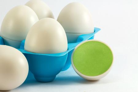 Toys egg trays, egg blue. The little birds in eggs Standard-Bild