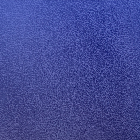 Dunkelblaue Lederbeschaffenheitsnahaufnahme. Blaue Wandtextur für Design. Abstrakter kobaltblauer Hintergrund. Vektor-Illustration. Vektorgrafik