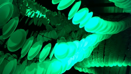 glow: Plates hanging as an abstract decor Stock Photo