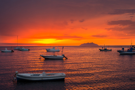 Sunset in mediterranean sea, Sicily Фото со стока