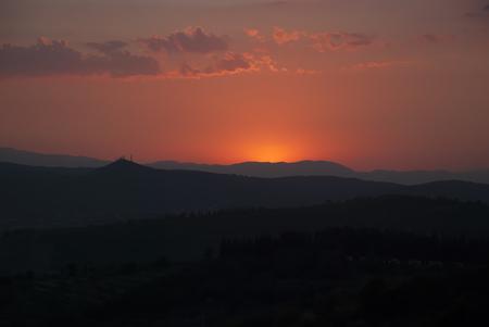 dark: sunset in tuscany, dark, mountains Stock Photo