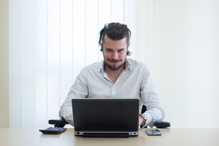 wornout: young businessman at work with laptop, worn-out Stock Photo