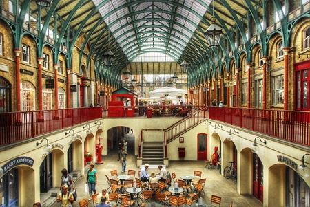 covent garden market: View of the Covent Garden market. People sitting on the terrace of a caf� downstairs