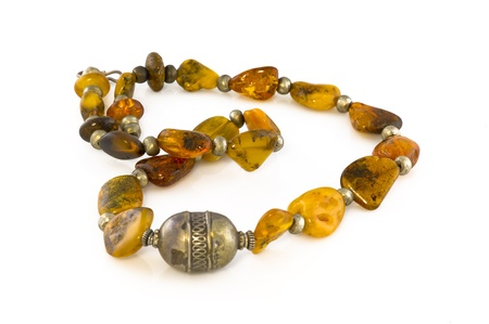 argent: It is a necklace made of amber and argent wisolated with a white background Stock Photo
