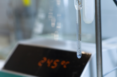 ph: It is a ph meter with the temperature in the background Stock Photo