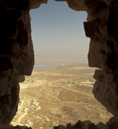 Vew from the Masada fortress. It can be seen, right at the bottom, Camp F, one of several legionary camps at Masada, just outside the circumvallation wall, the Dead sea and the Jordan in the background photo