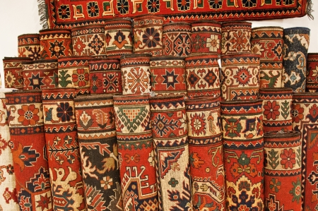 predominant: Set of exhibition carpets in a shop in Turkey  Red being the predominant color Stock Photo