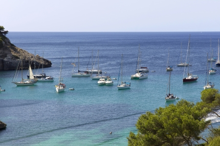 Sailboats anchored in Cala Galdana, Menorca photo