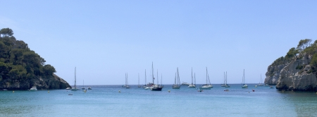 Sailboats anchored in a cove of Menorca photo