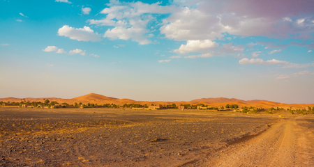 sandhills: The frontier in the Saara desert between the flat rocky land and the sand dunes. This interface is perfect for the construction of hotels, used during the whole year by tourists interested in the region.