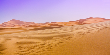 sandhills: Constrat of the Saara dunes and the sky after a sand storm. Stock Photo