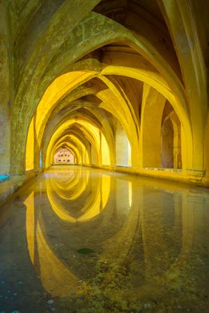 padilla: Rainwater tanks beneath the Patio del Crucero in the Alcazar of Seville, Spain. It is called the Baths of Lady Maria de Padilla. Editorial