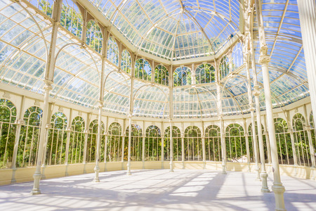 contemporaneous: The Crystal Palace (Palacio de Cristal) is located inside the Retiro park in Madrid, Spain. It is a metal structure used for expositions of contemporaneous art. Editorial