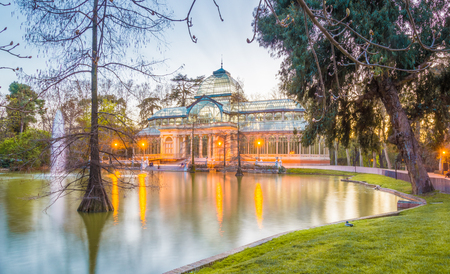 cristal: The Crystal Palace (Palacio de Cristal) is located in the Retiro park in Madrid, Spain. It is a metal structure used for expositions of contemporaneous art. It is a touristic attraction of the city.