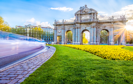 catalunia: The Alacala Door (Puerta de Alcala) is a one of the ancient doors of the city of Madrid, Spain. It was the entrance of people coming from France, Aragon, and Catalunia. It is a landmark of the city. Stock Photo