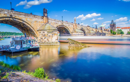 The Charles bridge is located in Prague, Czech Republic. Finished in the XV century, it is a medieval gothic bridge crossing the Vltava river. Its pillars are decorated with baroque statues of saints. Editorial