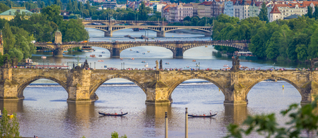 bridged: View of the main bridges of the Vltava river in Prague, Czech Republic. The Charles bridged is also seem in the scene.