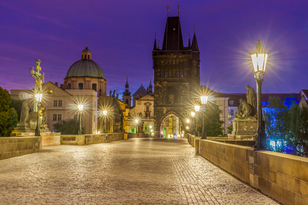 xv century: The Charles bridge is located in Prague, Czech Republic. Finished in the XV century, it is a medieval gothic bridge crossing the Vltava river. Its pillars are decorated with baroque statues of saints. Stock Photo
